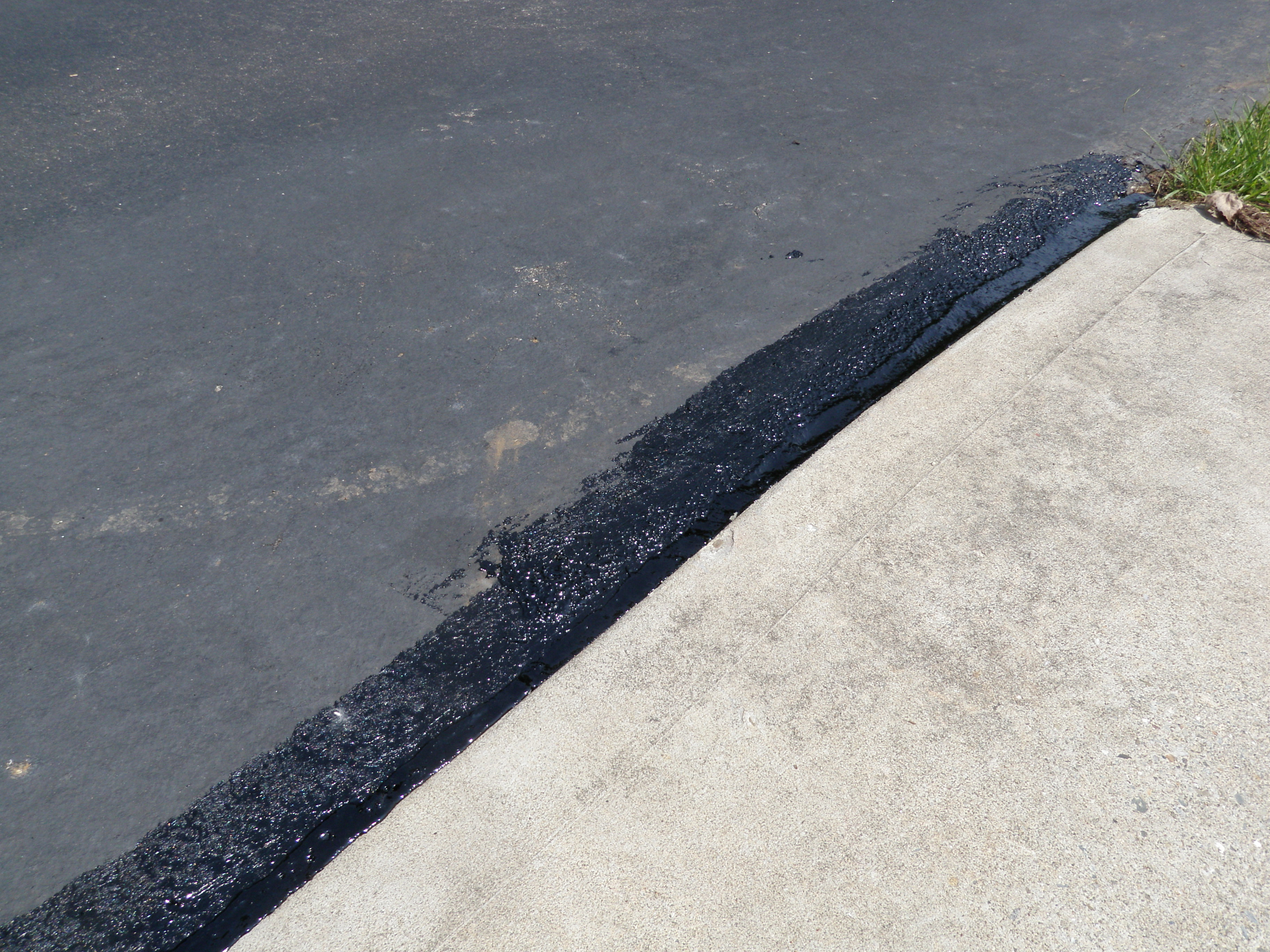 Driveway Sealant Application by Road