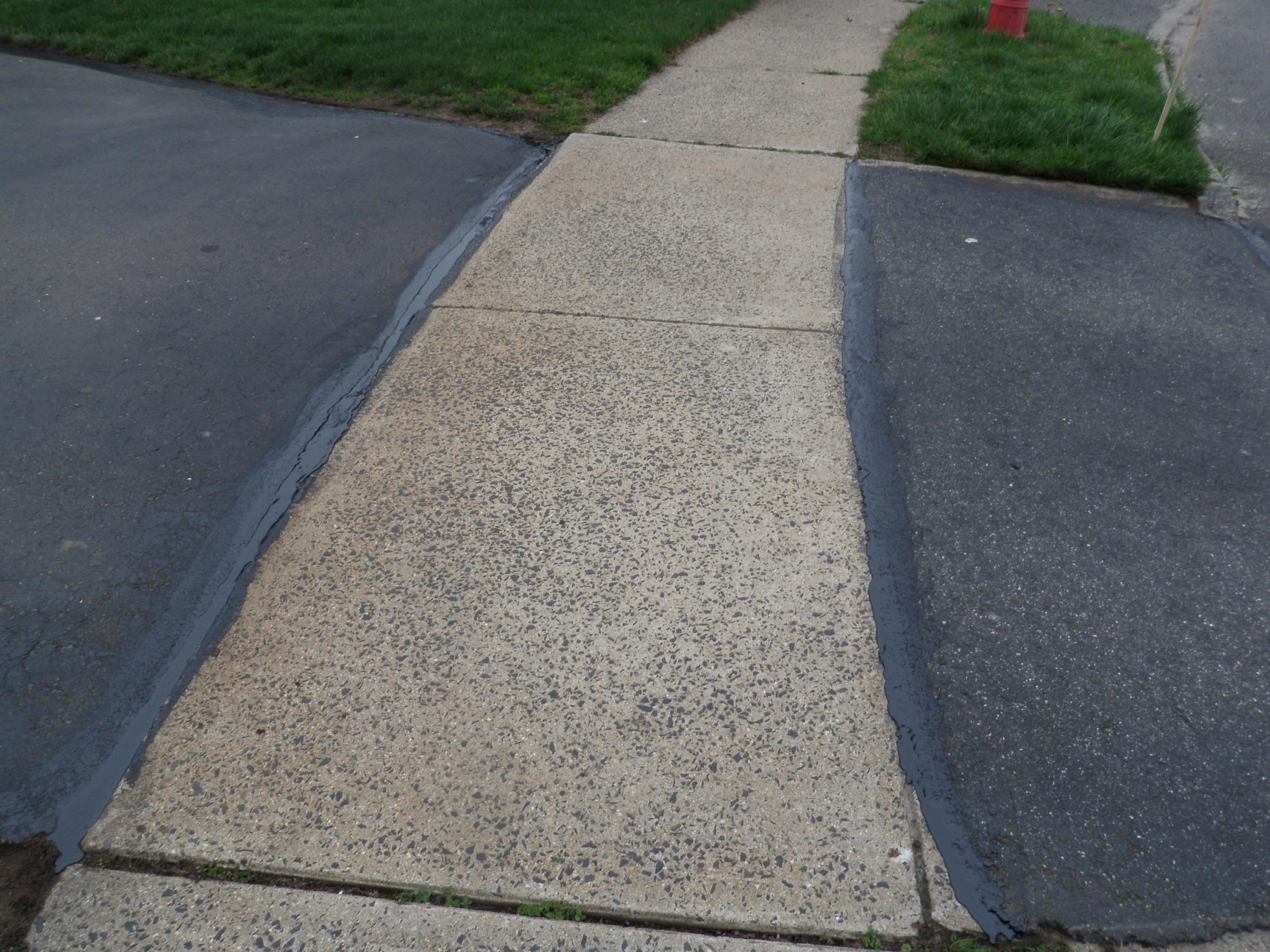 Driveway Sealant Each Side of Sidewalk