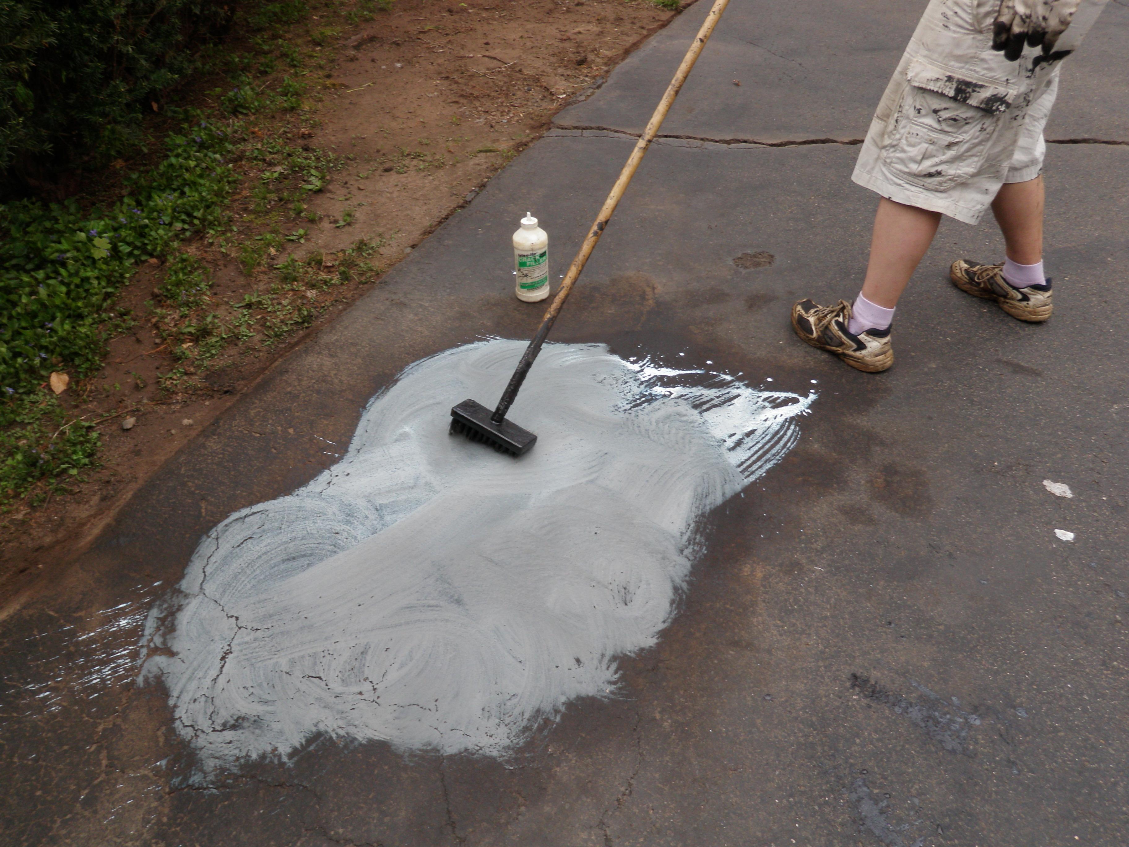 Scrubbing Driveway with Brush