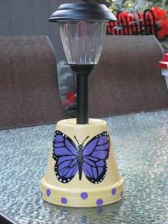 lamparas de jardín fáciles de hacer con materos de barro