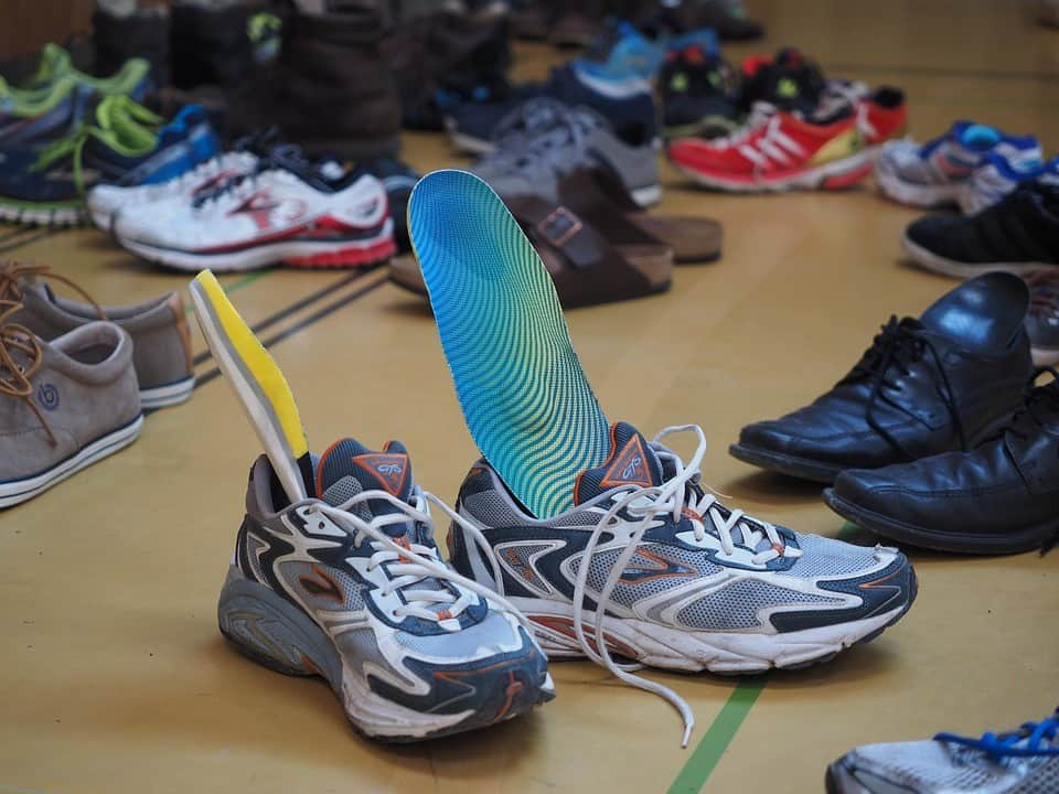 running shoes with insoles sticking out