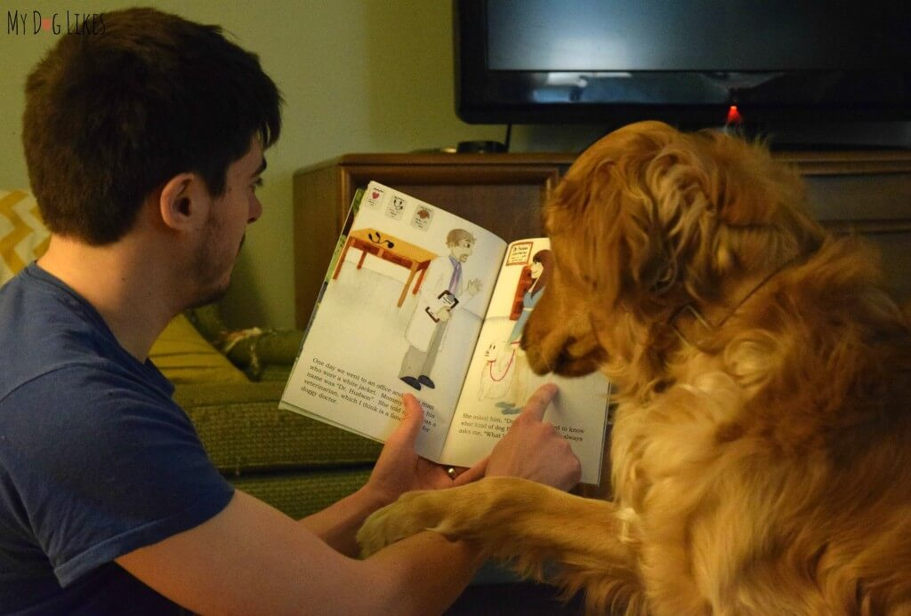 "Reading ""What Kind of Dog Am I?"" children's book to our dog Charlie. This story has a great message about adoption and identity."