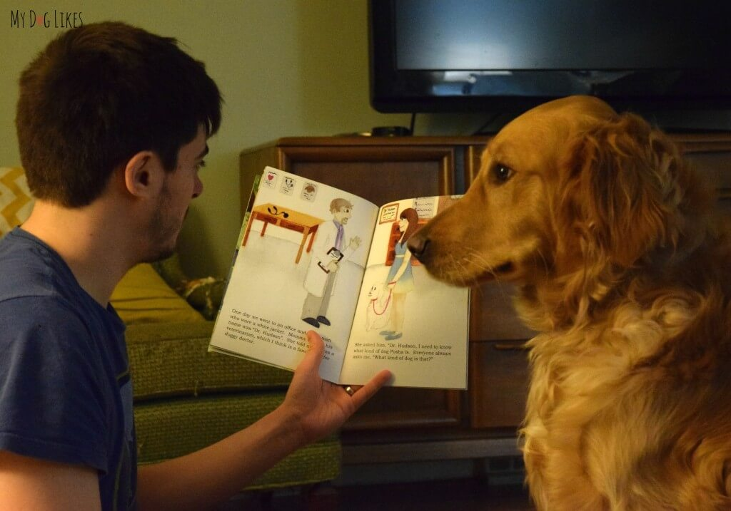 "Charlie listening closely to ""What Kind of Dog Am I?"" - a book that encourages children to better understand themselves and define their own identity"