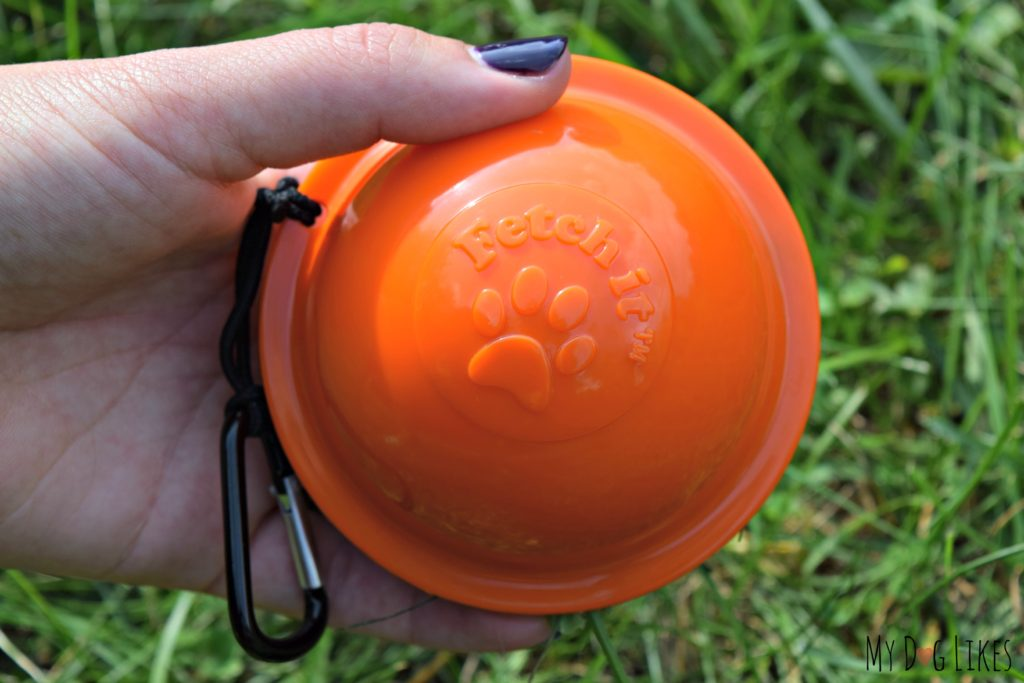Showing off a closed Fetch It Case - with a tennis ball inside