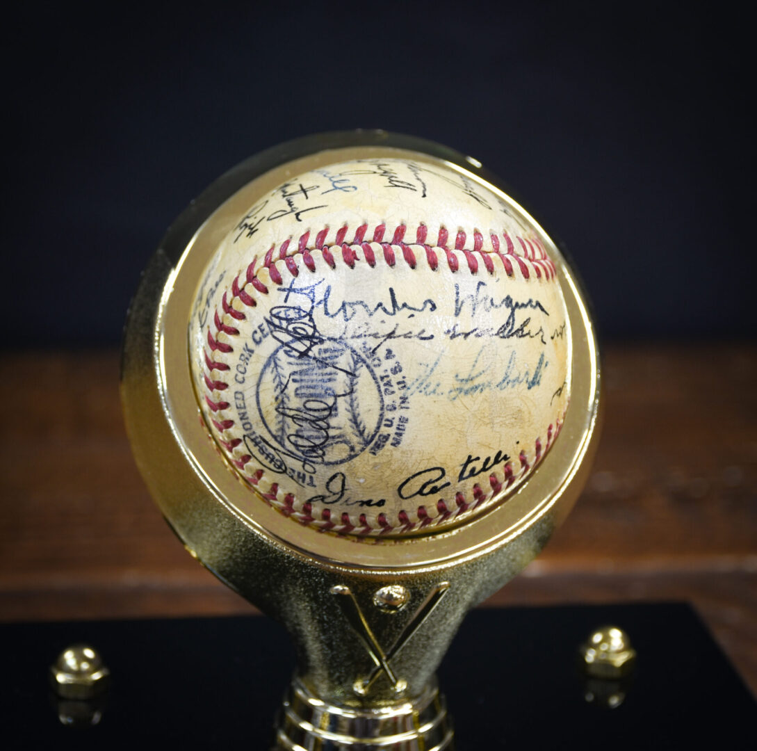 A baseball autographed by Honus Wagner