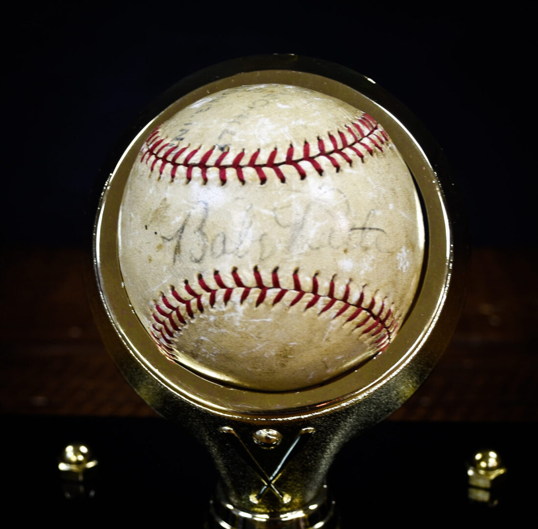 A baseball autographed by Babe Ruth