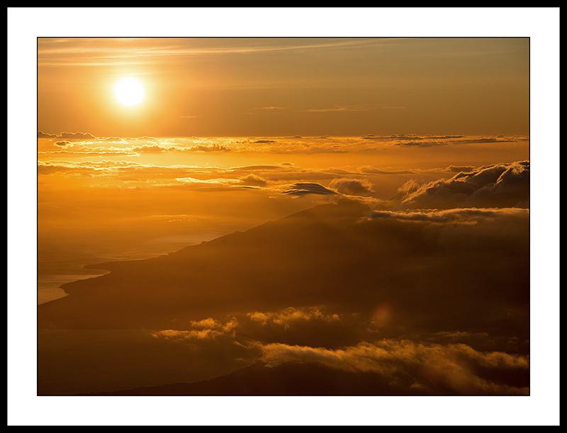 Sunset over Pacific Ocean from Haleakala National Park, Maui, Hawaii