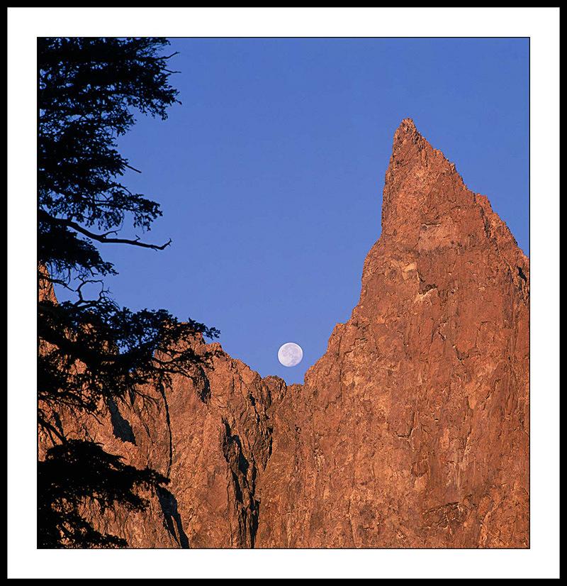 Full Moon Setting Behind Clyde Spire - Ansel Adams Wilderness, California