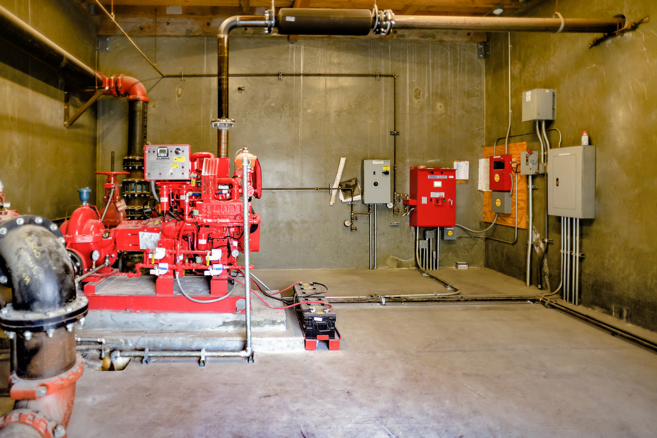 fire hydrant pump room with fire pump and water flow controls