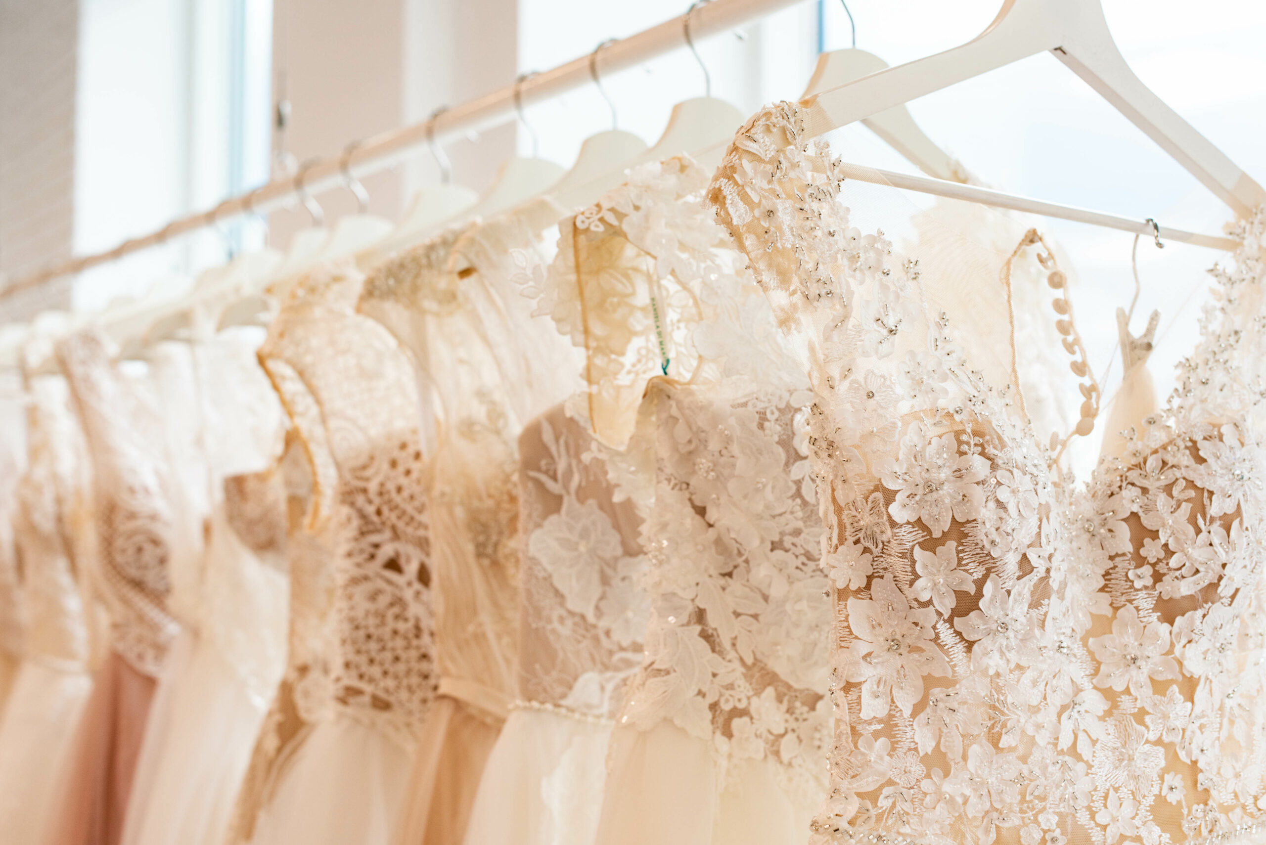 Wedding gowns that are sleeveless with sparkle and lace.