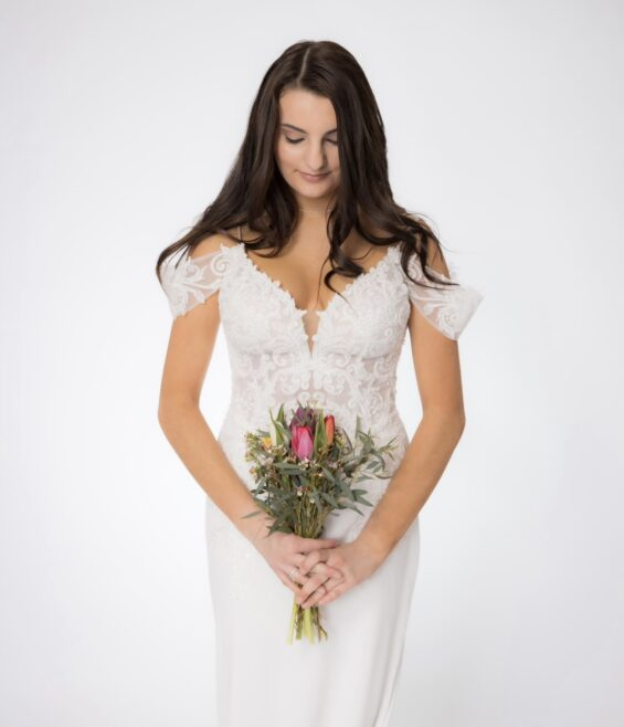 Off the shoulder wedding gown with beading in bridal shop