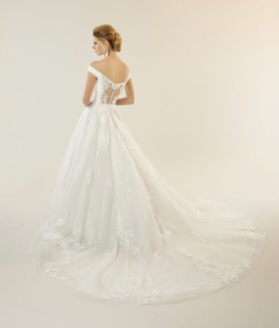 Gorgeous wedding dress with illusion back and lace train