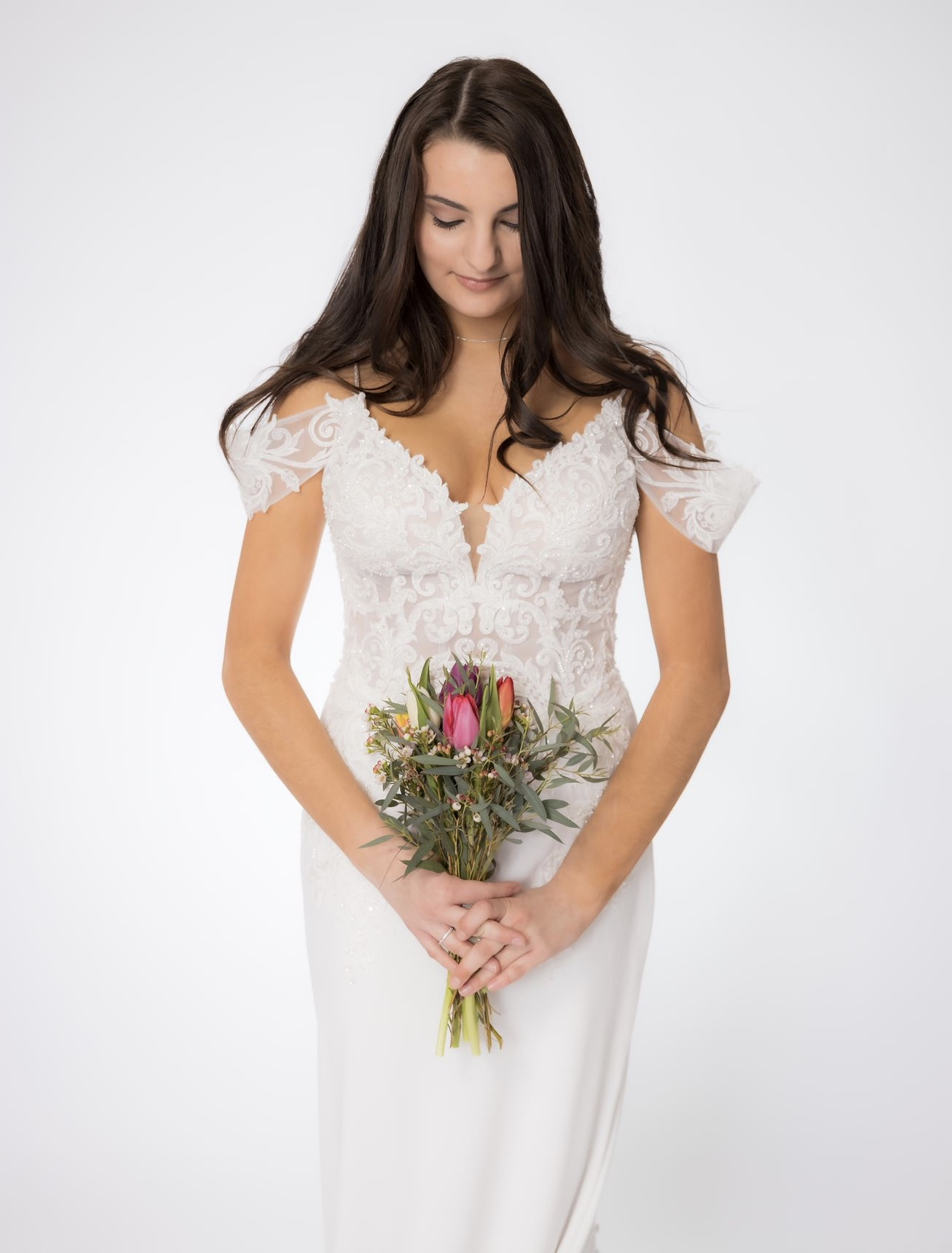 Lace off the shoulder beaded wedding dress in bridal shop
