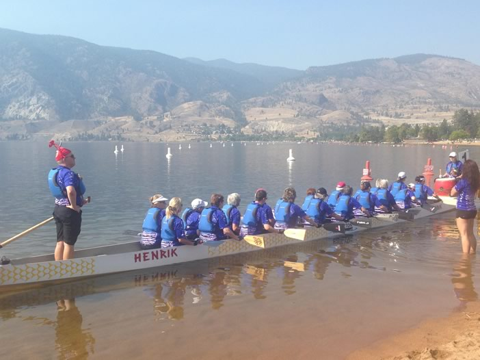 Our team in a dragon boat waiting to head out for a race.