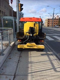 Yellow tractor in sidewalk