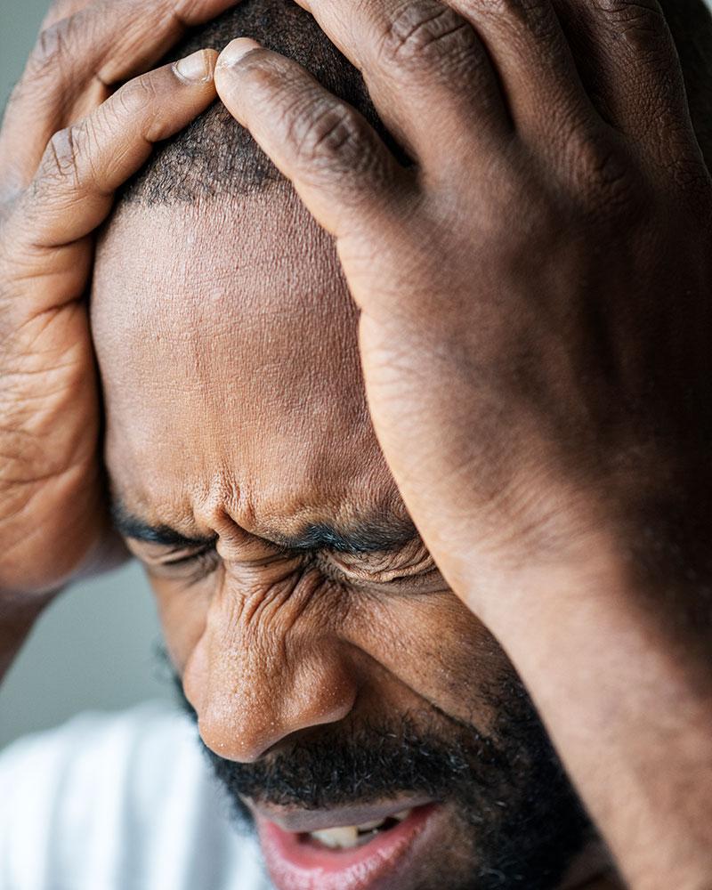 Black Man Suffering From Migraine