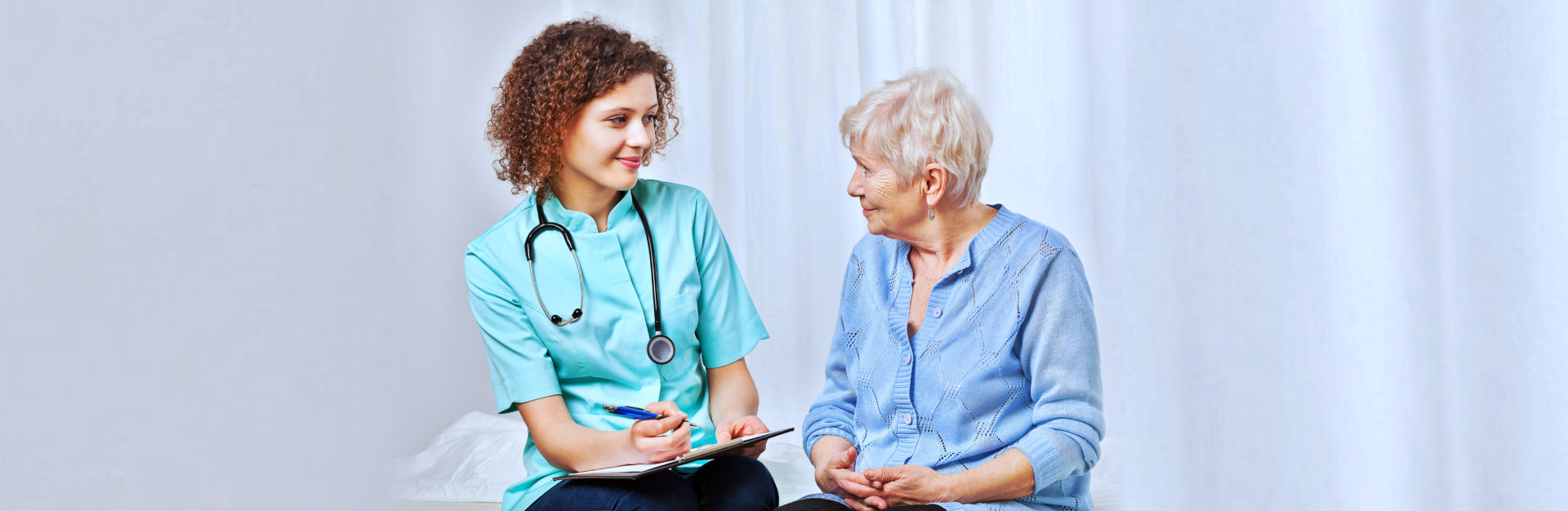 caregiver and senior woman talking