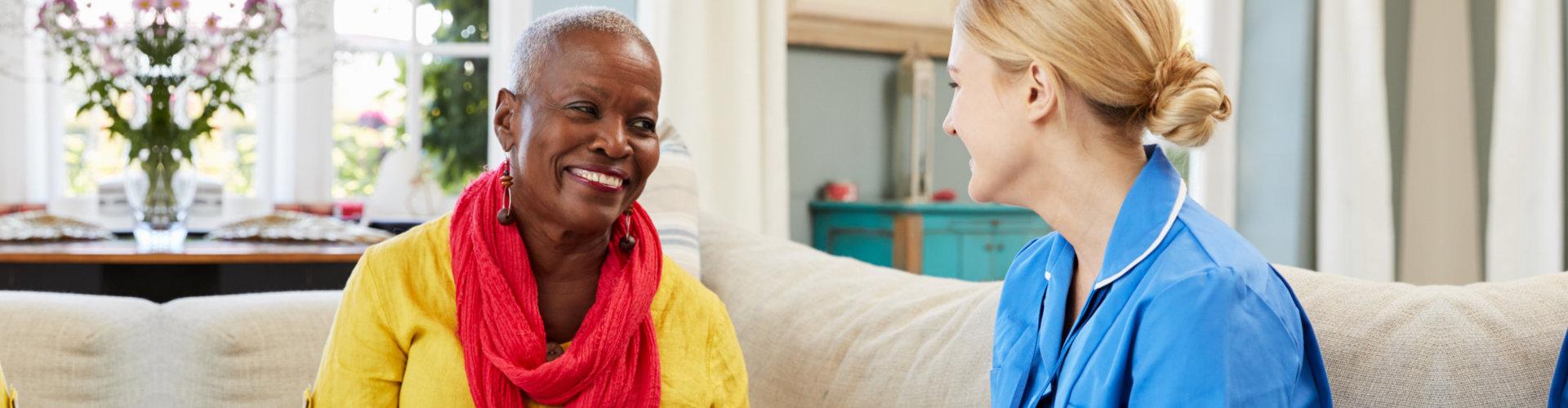 senior woman and caregiver talking