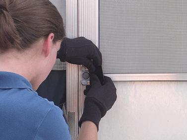 Applying Rugged Repair Patch to Door