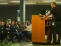 Suicide prevention speaker Jordan  Burnham delivering message to audience.
