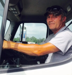 picture of Harold, propane delivery driver, sitting in cab of truck