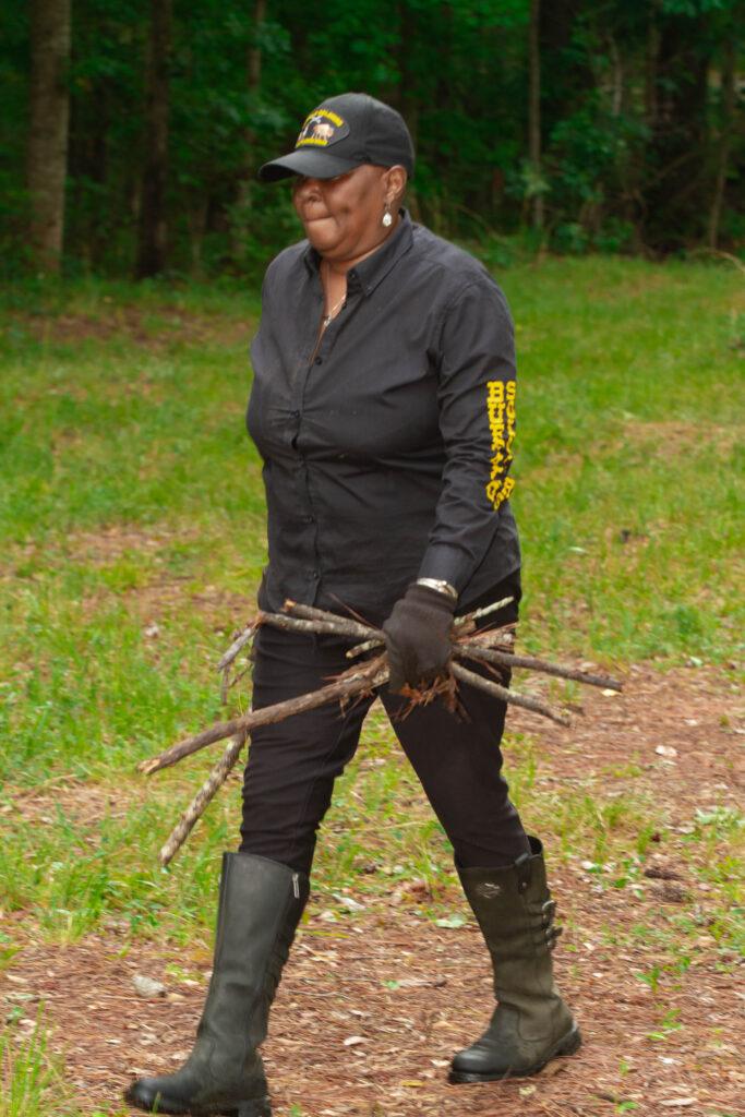 Woman carrying tree limbs