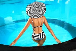 photo of woman in bathing suit at the edge of a pool | liposuction