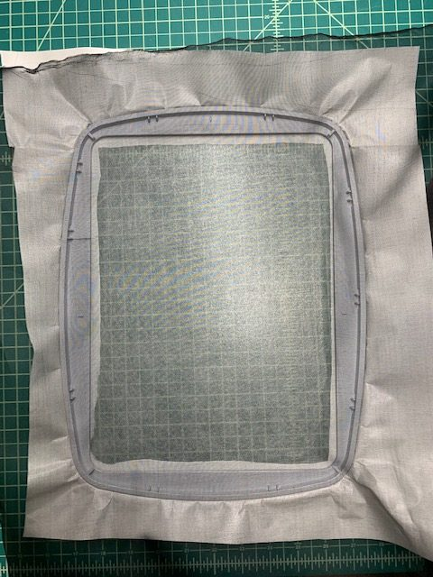 Embroidery on sheer fabric with metallic thread