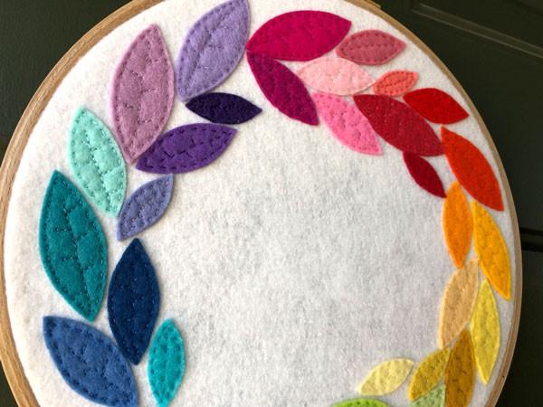 detail of rainbow felt wreath
