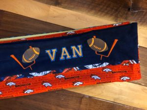 embroider a pillowcase with sports motif