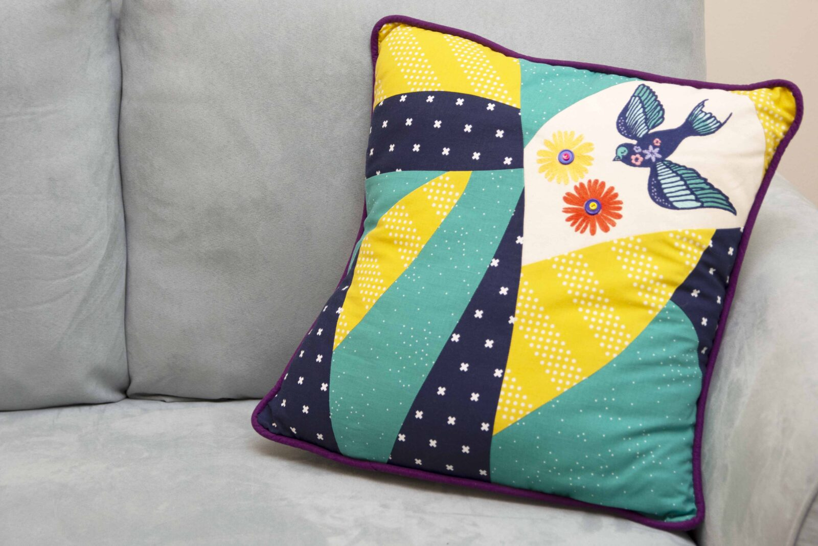 pieced pillow with embroidery
