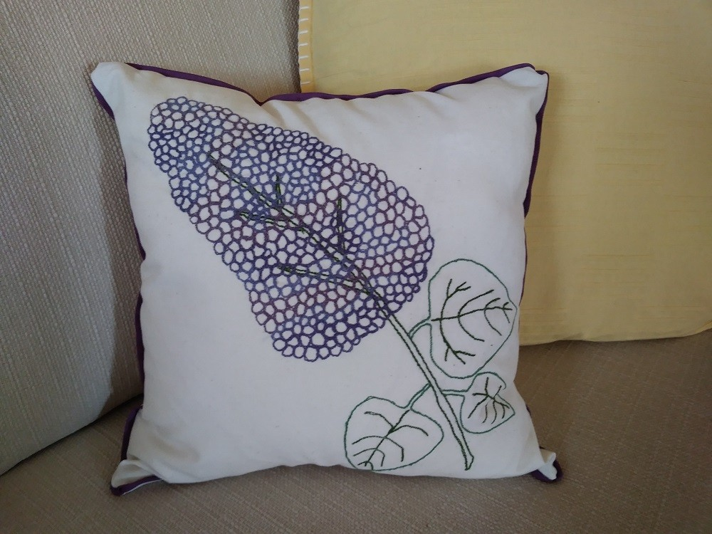 Lilac pillow with free-motion embroidery