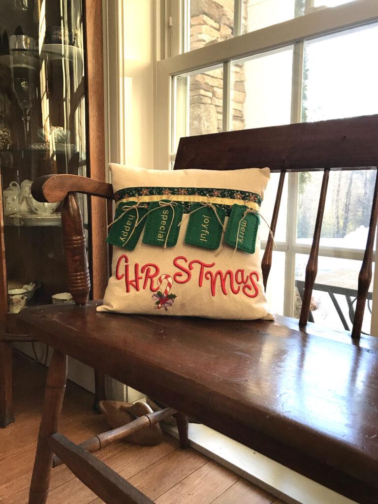 embroidered christmas pillow