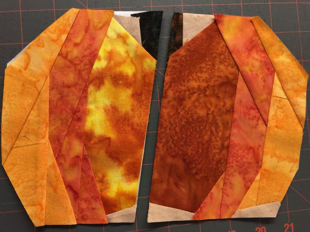 two halves of paper pieced pumpkin