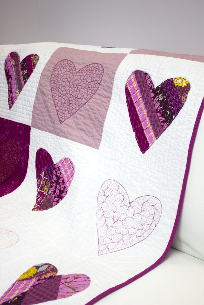 paper pieced heart quilt on couch