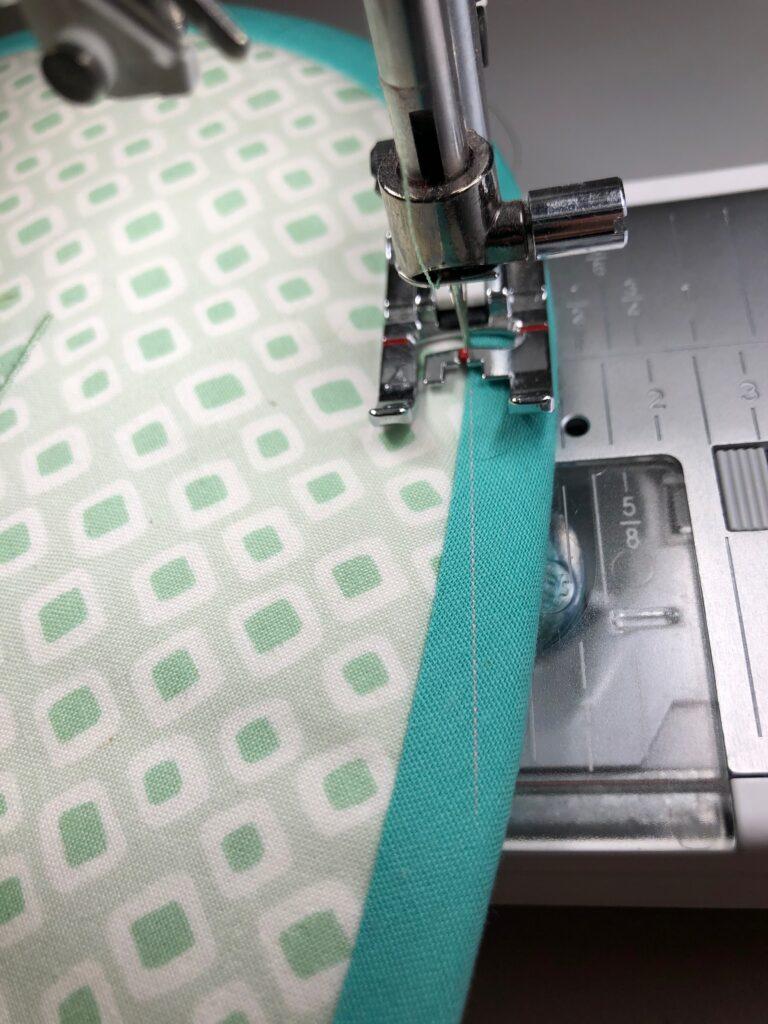 stitch in ditch of binding seam