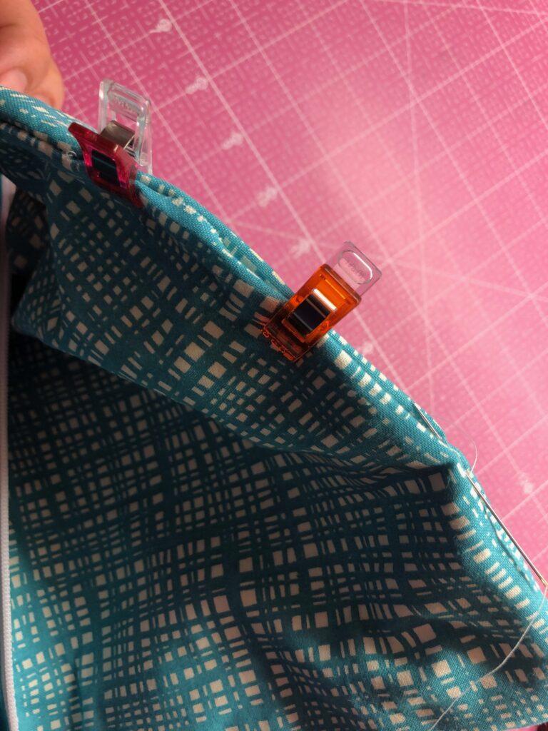 cli along zipper pouch opening
