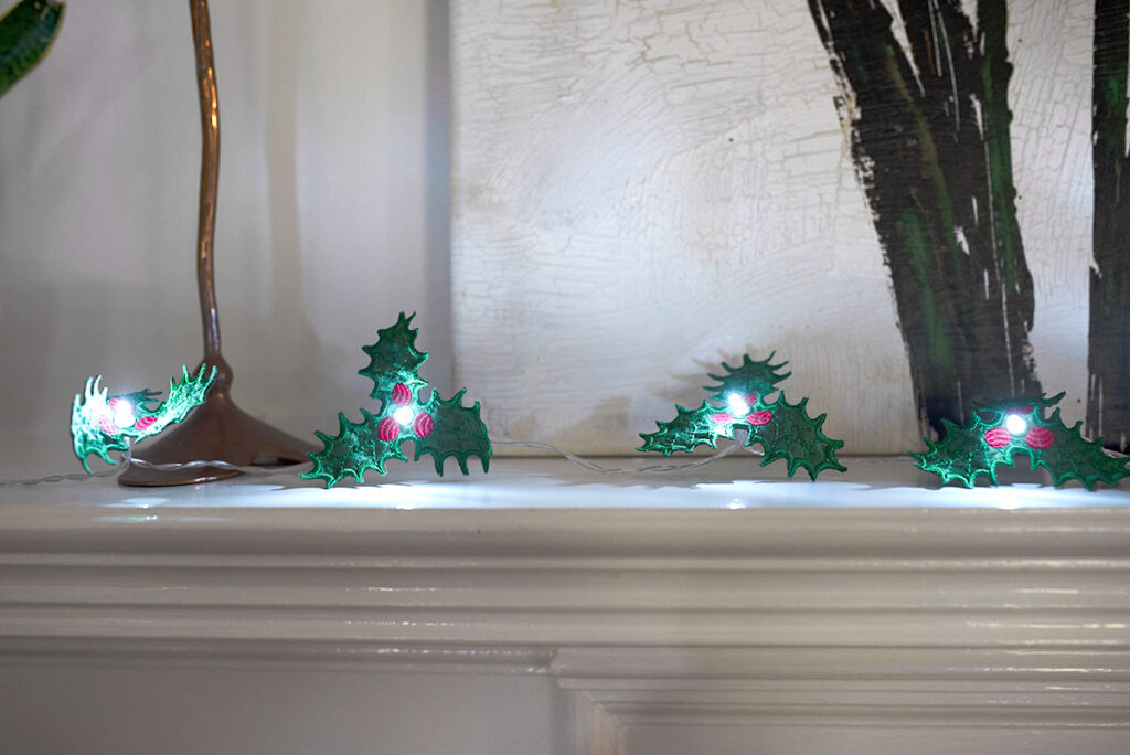 Free embroidery design holly string lights