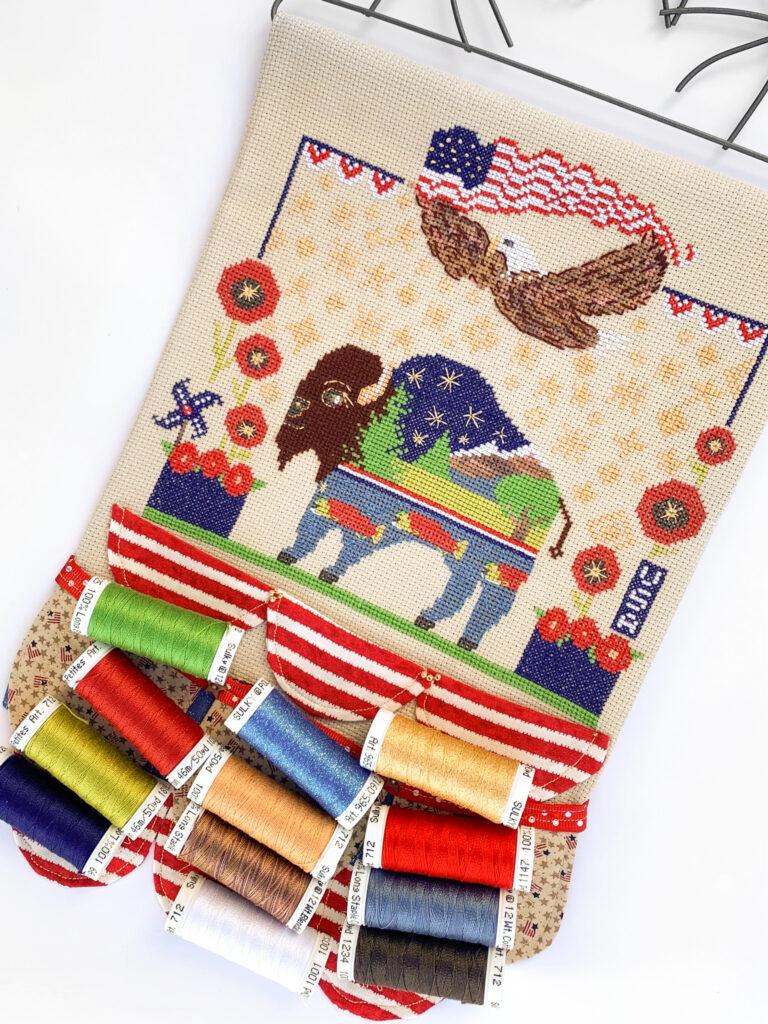 americana cross-stitch finished piece with threads