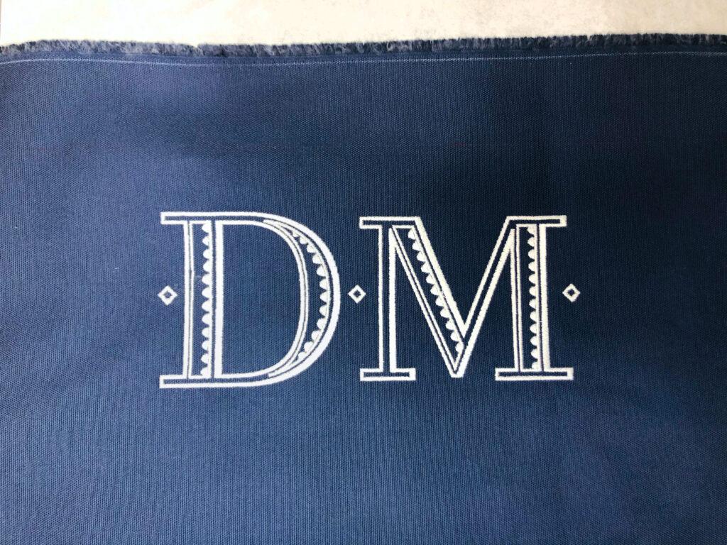 three total diamonds embroidered on bag