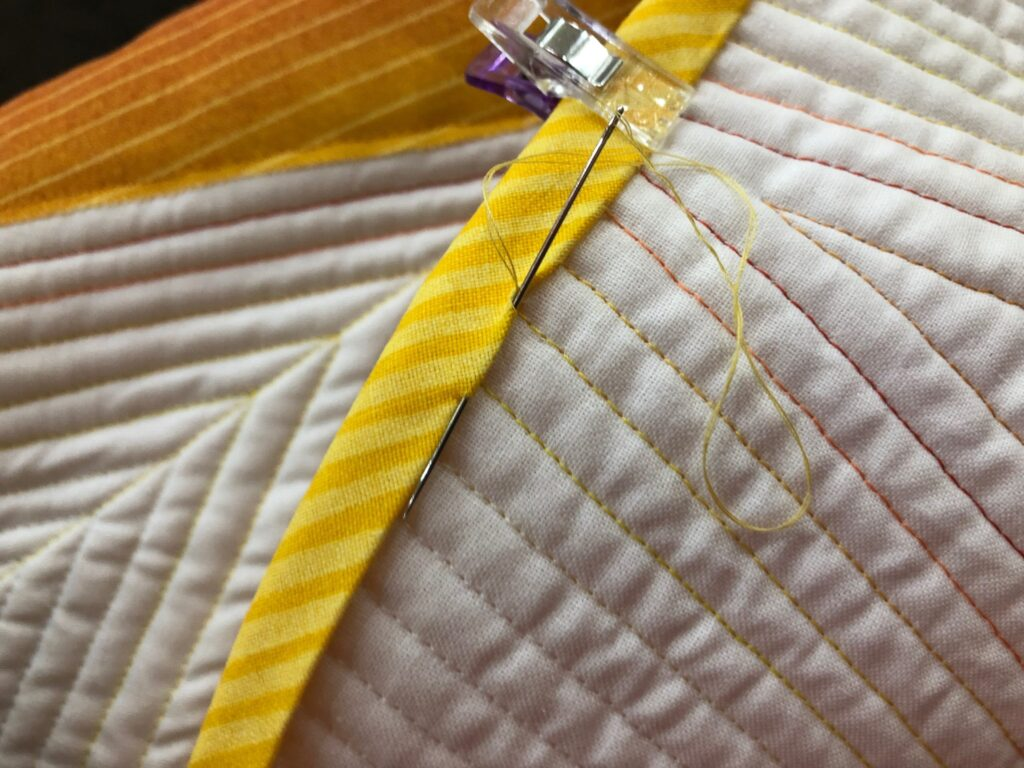 hand sew binding to back of table topper
