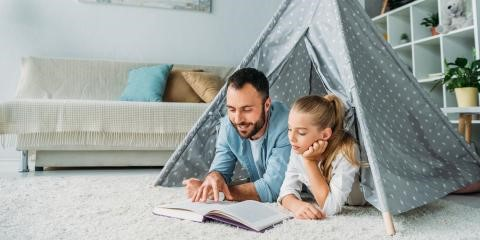 Father and daughter in a tent