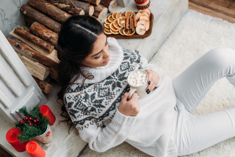 girl sitting on floor with mug in hand