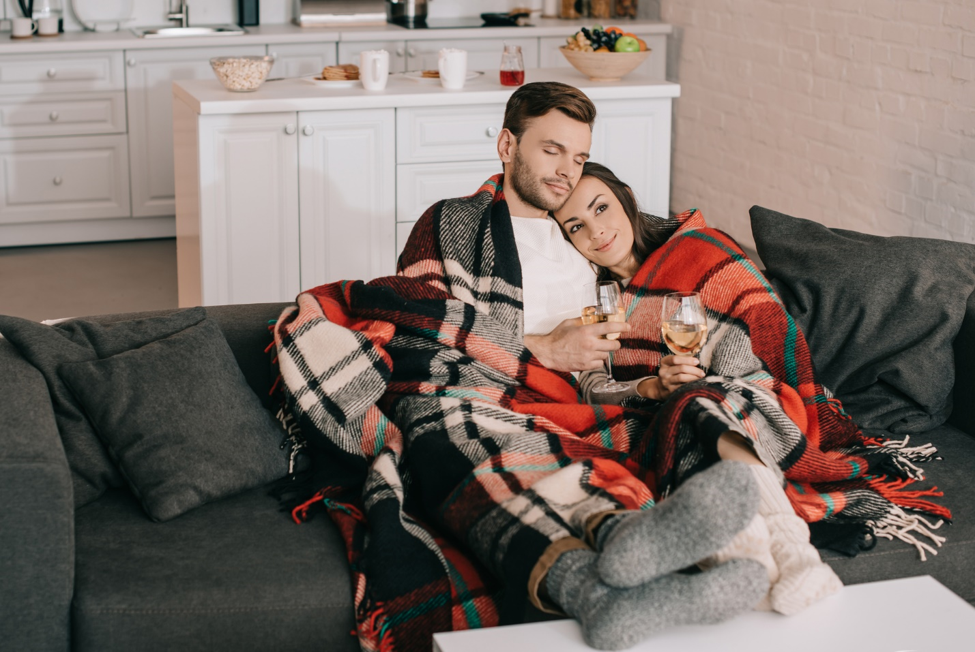 woman and man sitting next to each other on couch
