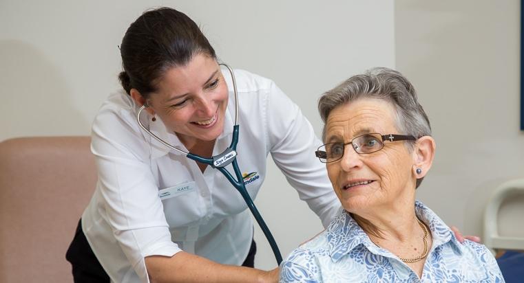Nurse Practitioner assessing resident Joan