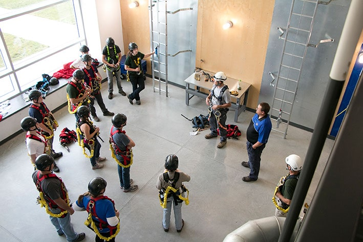 Students from the Iowa Lakes Community College Wind Energy Program listening to instructions