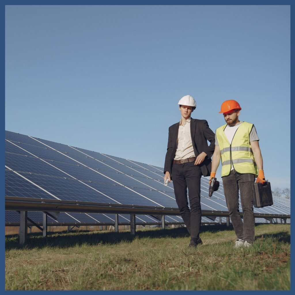 Renewable Energy Education Resources - Technician and supervisor walking past solar panels to represent Career Maps