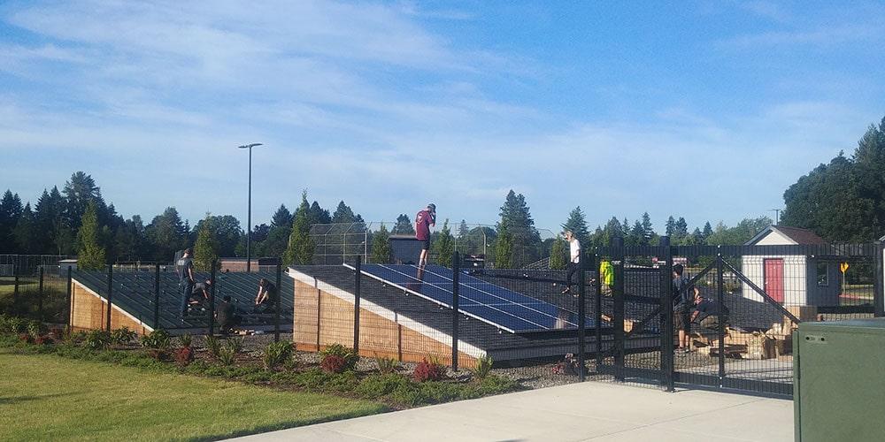 Students installing solar panels at Clackamas community college