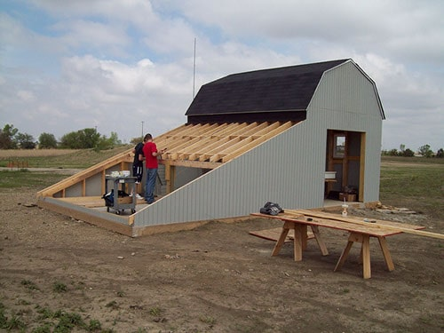 Students from Heartland Community College's Intro to Solar program, prepping the side of a barn for solar panels