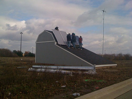 Students at Heartland Community College installing solar panels on a roof